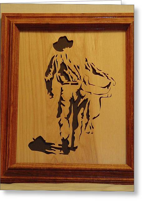 Saw Sculptures Greeting Cards - Cowboy and Saddle Greeting Card by Russell Ellingsworth