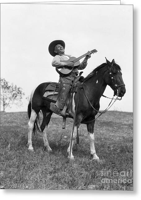 Cowboy On Horse Singing And Playing Greeting Card by H. Armstrong Roberts/ClassicStock