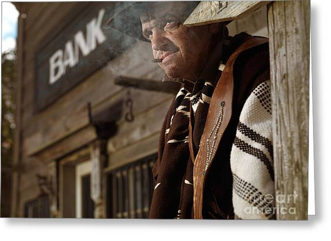 Cowboy Outfit Greeting Cards - Cowboy Smoking a Cigar Outside of a Bank Building Greeting Card by Oleksiy Maksymenko