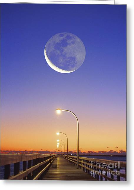 Crescent Moon Rises Over Pier Greeting Card by Larry Landolfi