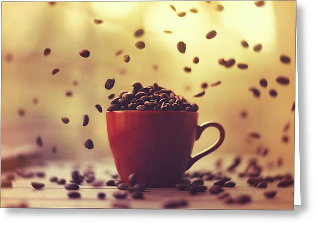Beans Greeting Cards - Cup Full Of Coffee Beans And Falling Coffee Beans Greeting Card by Ashraful Arefin