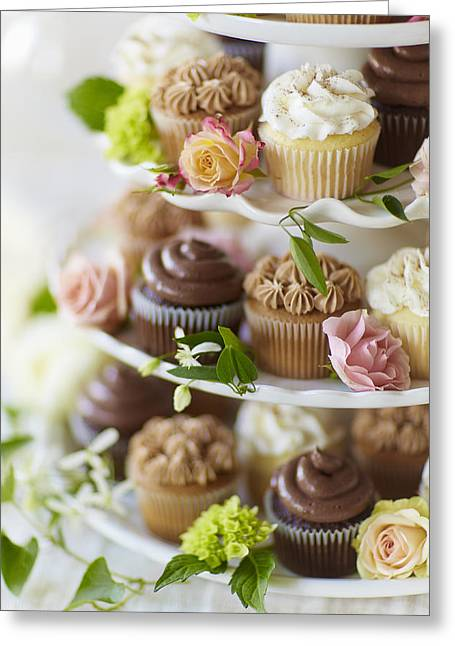 Cakes Greeting Cards - Cupcakes And Flowers On Tiered Stand Greeting Card by Gillham Studios