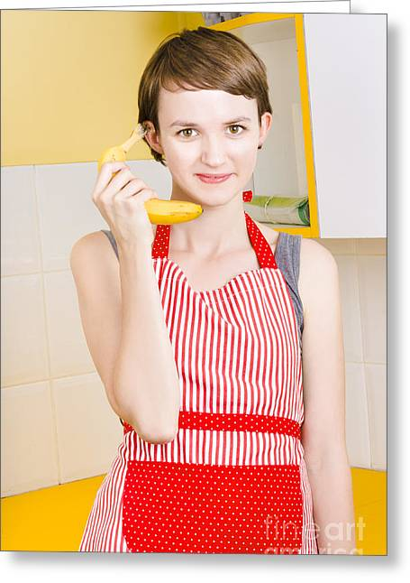 Pretense Greeting Cards - Cute girl talking on fruit phone in kitchen Greeting Card by Ryan Jorgensen
