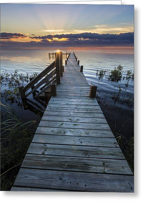 Foggy Beach Greeting Cards - Dawn Over the Docks Greeting Card by Debra and Dave Vanderlaan