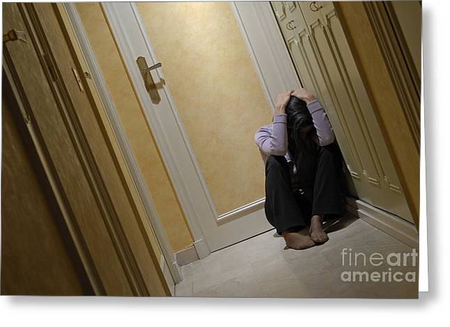 Best Sellers -  - Distraught Greeting Cards - Depressed woman sitting in corridor with head in hands Greeting Card by Sami Sarkis