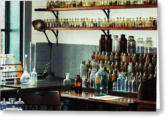 Desk With Bottles Of Chemicals Greeting Card by Susan Savad