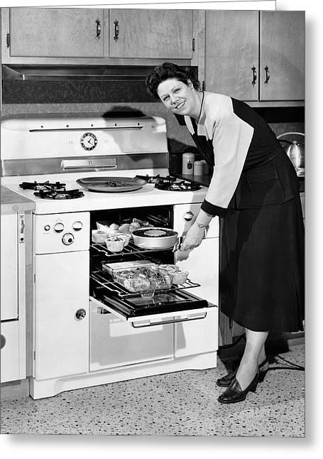 1950s Portraits Greeting Cards - Dinner In The Oven Greeting Card by Underwood Archives