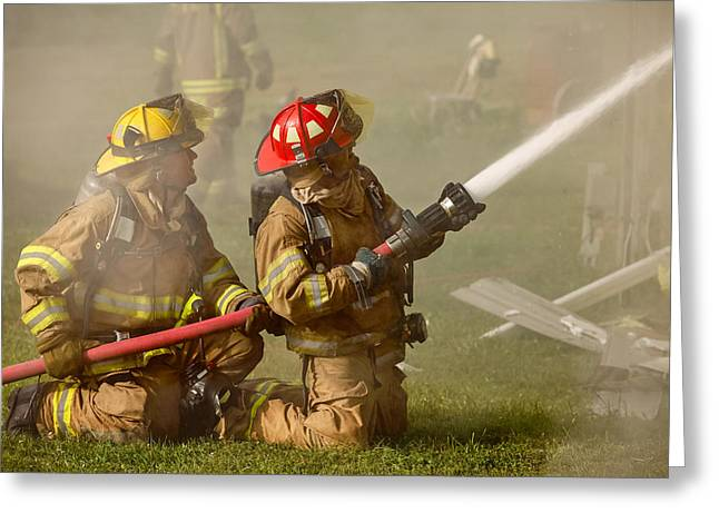 Dousing The Flames Greeting Card by Todd Klassy