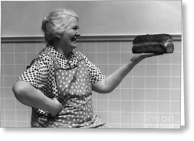 1930s Candid Greeting Cards - Elderly Woman Admiring Loaf Of Bread Greeting Card by H. Armstrong Roberts/ClassicStock