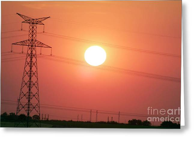 Electrical pylon at silhouetted at sunset Greeting Card by Sami Sarkis
