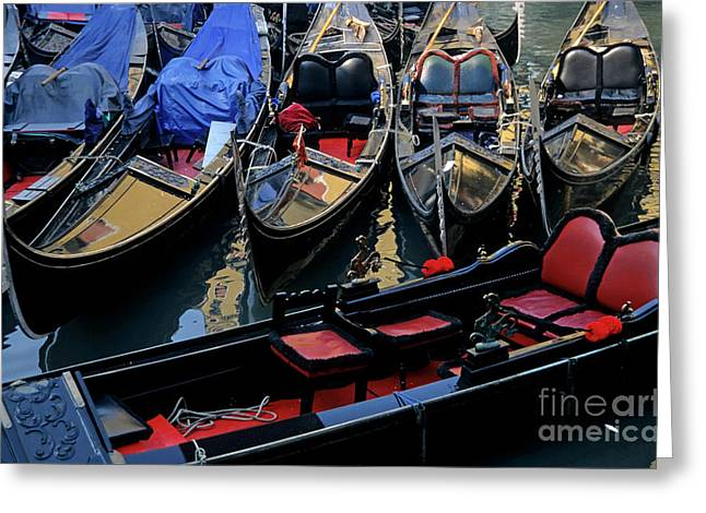 Boats On Water Greeting Cards - Empty gondolas floating on narrow canal in Venice Greeting Card by Sami Sarkis