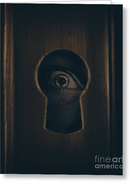Peepholes Greeting Cards - Eye looking through door keyhole Greeting Card by Ryan Jorgensen