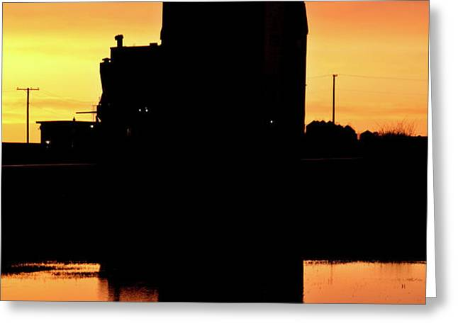 Eyebrow gain elevator reflected off water after sunset Greeting Card by Mark Duffy