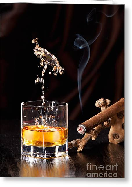 Party Greeting Cards - Fallen ice cubes causing a splash in the Whisky glass Greeting Card by Wolfgang Steiner