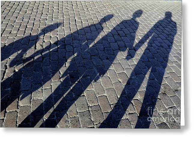 Bonding Greeting Cards - Family of four casting shadows on cobbled stone street Greeting Card by Sami Sarkis