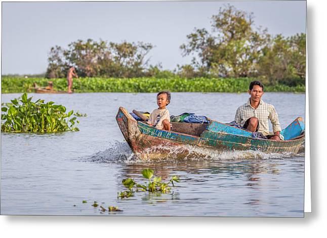 Fishing Boats Greeting Cards - Father and Son- Tonle Sap Lake Greeting Card by Cindi Alvarado
