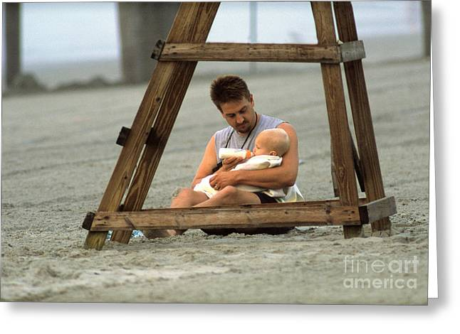 Father And Son Greeting Cards - Father Feeding His Baby Son Greeting Card by George Mattei