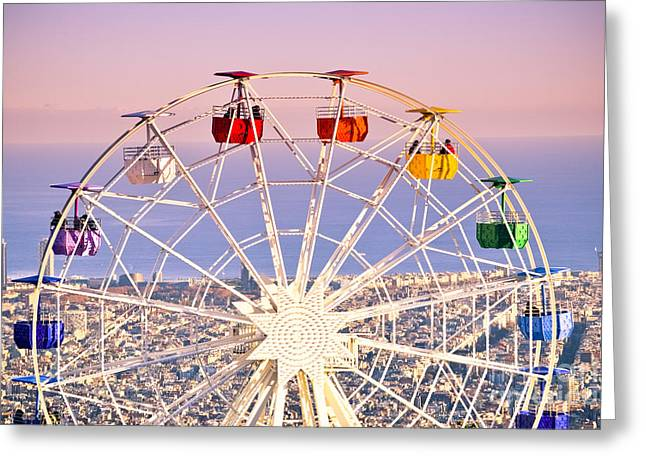 Ocean Panorama Greeting Cards - Ferris wheel at sunset. Greeting Card by Marc SOLERMARCE