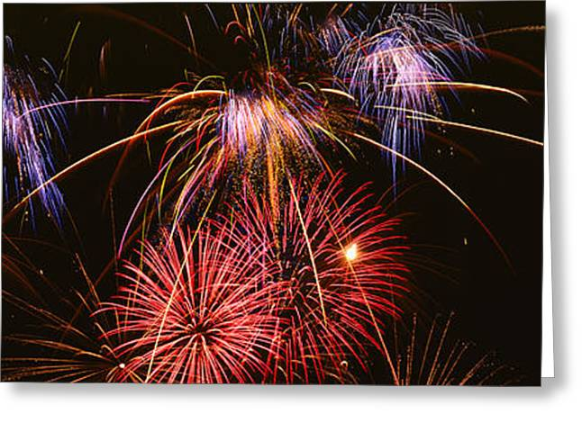 Fire Works Greeting Cards - Fireworks Exploding Against Night Sky Greeting Card by Panoramic Images