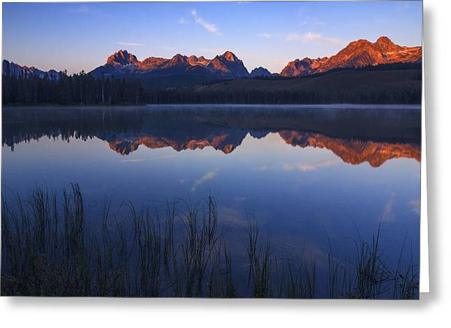 Reflections Of Sky In Water Greeting Cards - First light illuminating Sawtooth Mountains Stanley Idaho Greeting Card by Vishwanath Bhat