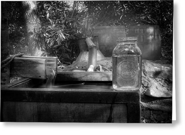 Water Jars Greeting Cards - First Run Of Moonshine in Black and White Greeting Card by Greg Mimbs
