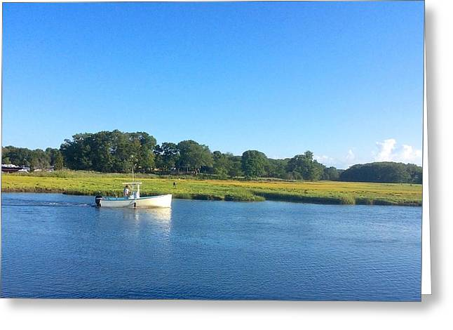 Fishing Boats Greeting Cards - Fishing boat traveling through the marsh in Essex, Massachusetts. Greeting Card by Suzanne McDonald