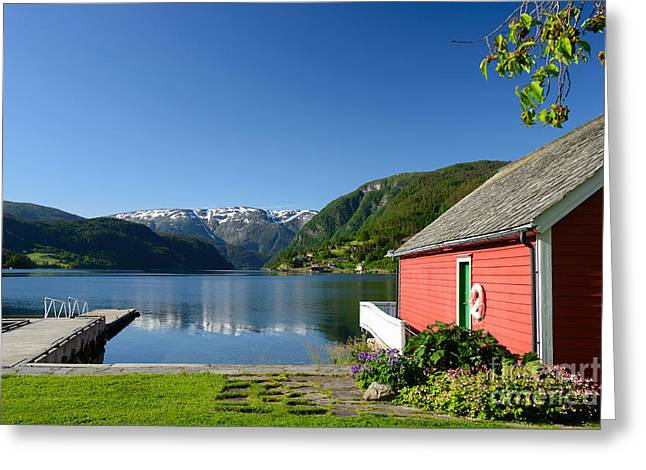 Norwegian Boathouses Greeting Cards - Fjord view with boathouse Greeting Card by IPics Photography