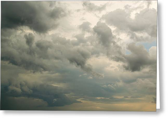 Overcast Day Greeting Cards - Fluffy Rain Clouds Against Cloud Filled Sky Greeting Card by John Williams
