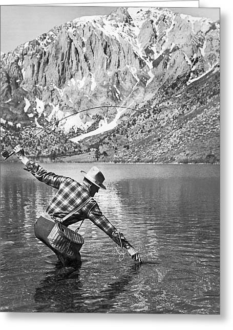 Trout Fishing Greeting Cards - Fly Fishing In A Mountain Lake Greeting Card by Underwood Archives