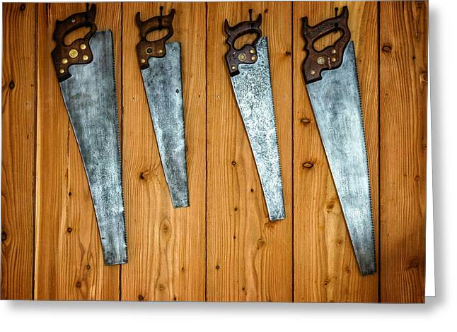 Saw Greeting Cards - Four Saws on a Wall Greeting Card by Chris Bordeleau