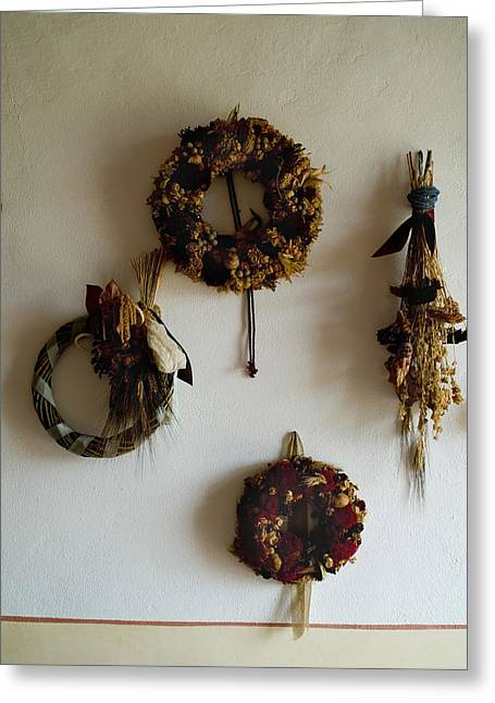 Chianti Greeting Cards - Four Wreaths Hang On The Wall Greeting Card by Todd Gipstein