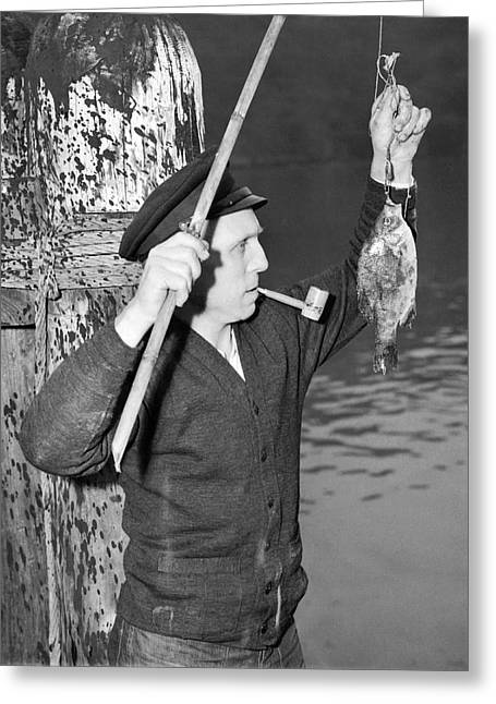 Angels Smoking Greeting Cards - German Crewman Fishes In SF Greeting Card by Underwood Archives