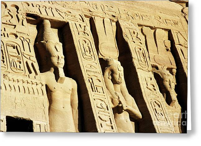 Archaeology Archeological Greeting Cards - Giant statues outside the Ramses II and Queen Nefertiti Temple at Abu Simbel Greeting Card by Sami Sarkis