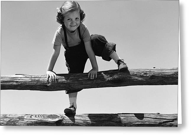 Girl Climbing Over Wooden Fence Greeting Card by H. Armstrong Roberts/ClassicStock