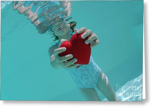 Swimsuit Photography Greeting Cards - Girl holding heart shaped symbol in swimming pool Greeting Card by Sami Sarkis
