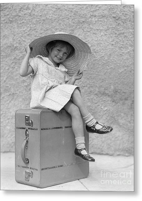 Girl Sitting On Suitcase With Big Straw Greeting Card by H. Armstrong Roberts/ClassicStock