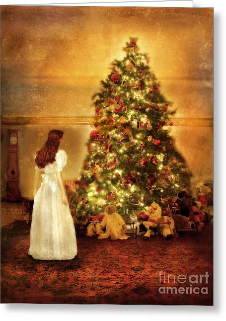 Young Lady Greeting Cards - Girl Standing in Wonder by Christmas Tree Greeting Card by Jill Battaglia
