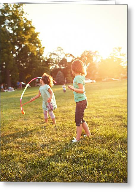Caucasian Greeting Cards - Girls Playing Together On Evening Lawn Greeting Card by Gillham Studios