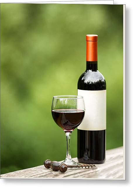 Wine-glass Greeting Cards - Glass of red wine outdoors ready to enjoy Greeting Card by Tom  Baker