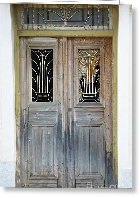 Greek Door With Wrought Iron Window Greeting Card by Maria Varnalis