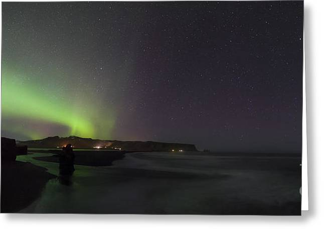 Reflection In Water Greeting Cards - Green Aurora Borealis Over Iceland Greeting Card by Babak Tafreshi