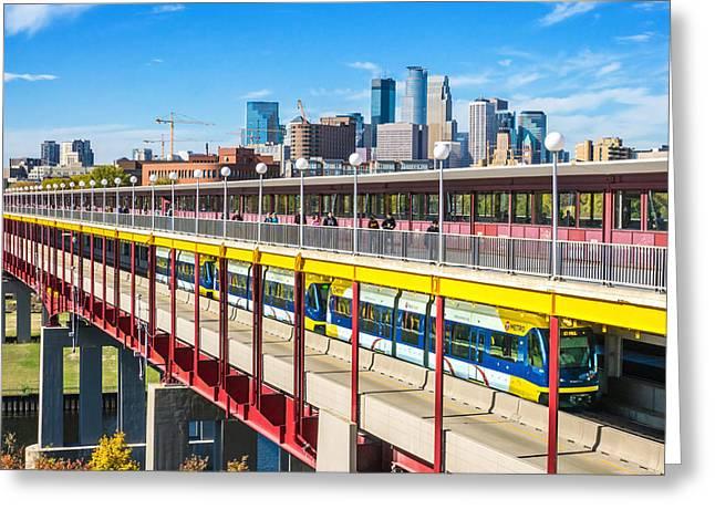 University Of Minnesota Greeting Cards - Green Line light rail in Minneapolis Greeting Card by Jim Hughes