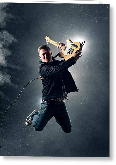 Musical Photographs Greeting Cards - Guitarist jumping high Greeting Card by Johan Swanepoel