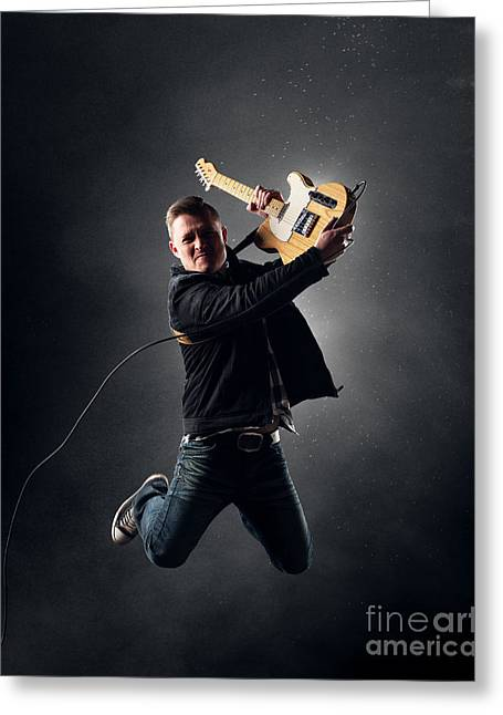 Play Photographs Greeting Cards - Guitarist jumping high Greeting Card by Johan Swanepoel