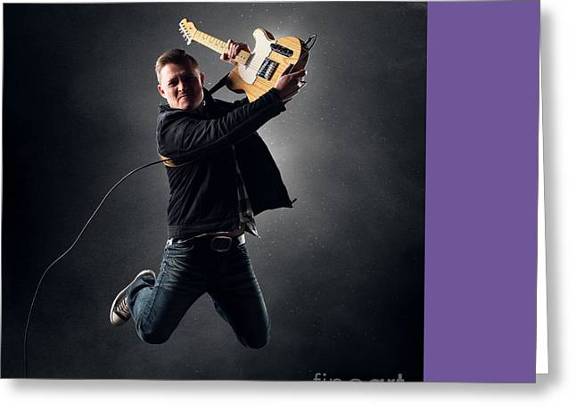 Caucasian Greeting Cards - Guitarist jumping on stage Greeting Card by Johan Swanepoel