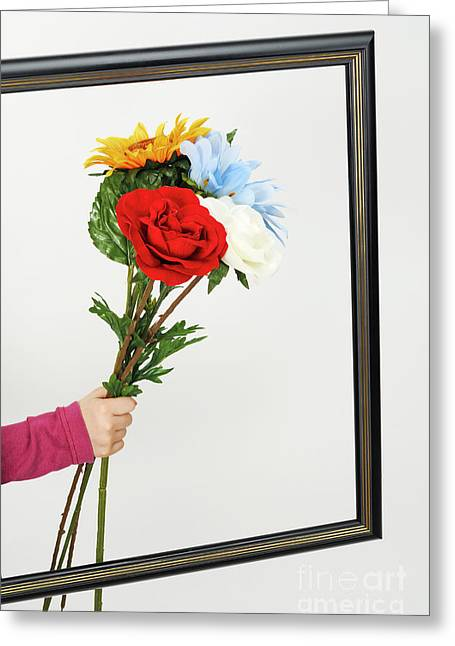 Children Only Greeting Cards - Hand of girl holding flowers over empty picture frame Greeting Card by Sami Sarkis