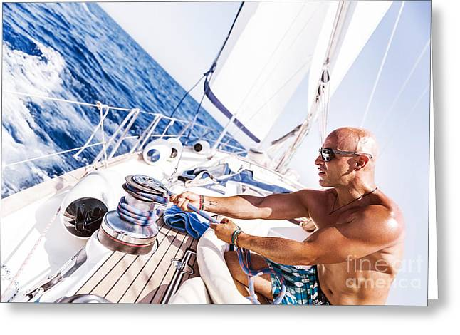 Sailing Ship Greeting Cards - Handsome man working on sailboat Greeting Card by Anna Omelchenko