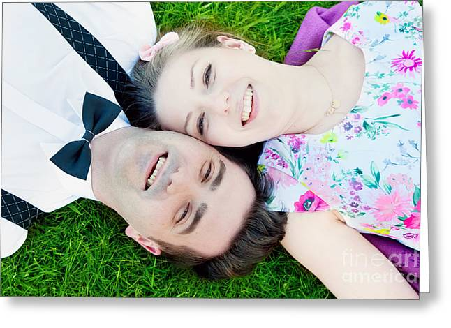 Happy Couple In Love Lying On Summer Grass And Smiling Greeting Card by Michal Bednarek