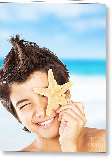 Preteen Greeting Cards - Happy face boy with starfish on the beach Greeting Card by Anna Omelchenko