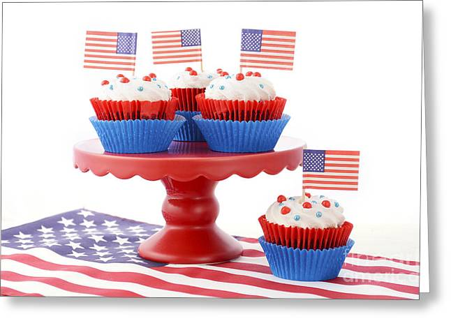 American Independance Greeting Cards - Happy Fourth of July Cupcakes on Red Stand Greeting Card by Milleflore Images